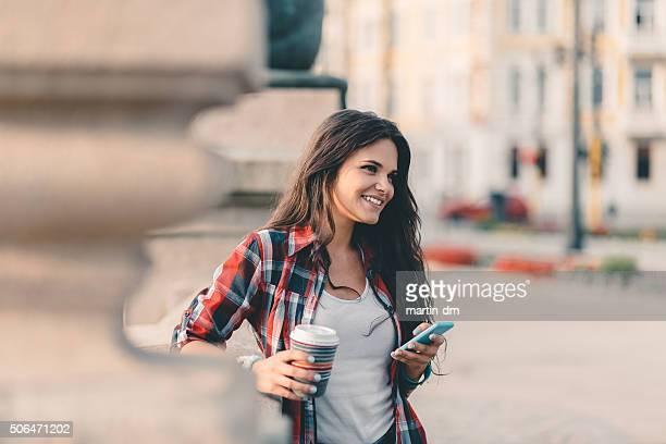 Teenage girl using smartphone in the city