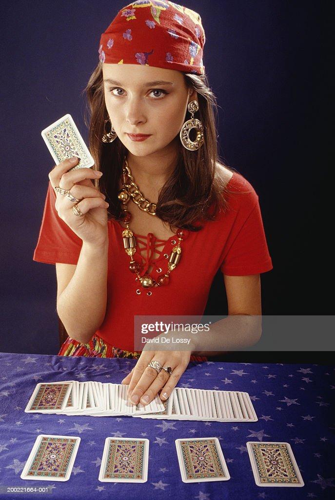 Teenage girl (16-17) using tarot cards, portrait : Stock Photo