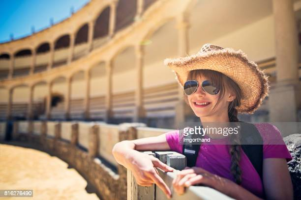 Teenage girl, visiting a bullring in Spain