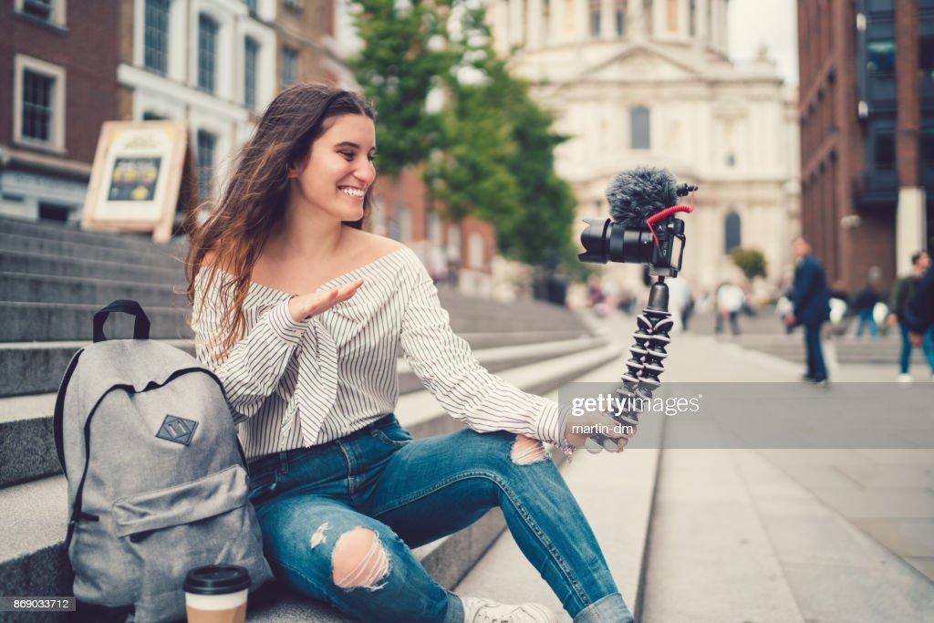 Teenage girl vlogging from London : Stock Photo