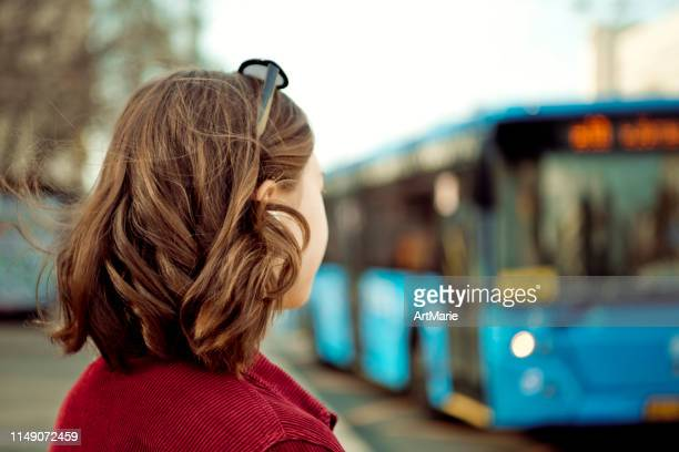 teenage girl waiting for bus - waiting stock pictures, royalty-free photos & images