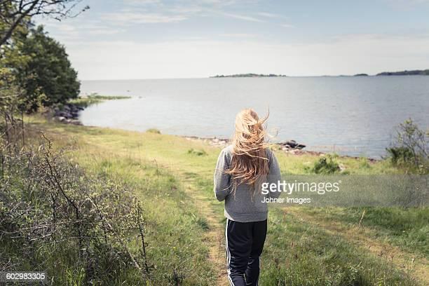 Teenage girl walking at sea