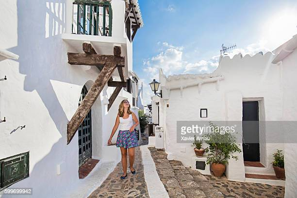 teenage girl walking in the streets of binibequer vell - ミノルカ ストックフォトと画像