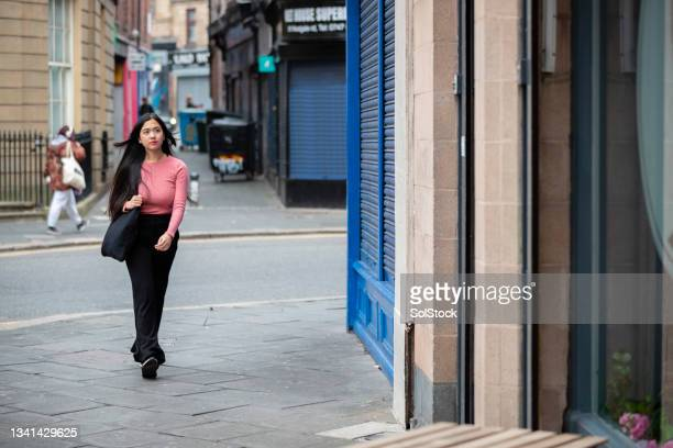 teenage girl walking to her hairdressers - ambient light stock pictures, royalty-free photos & images