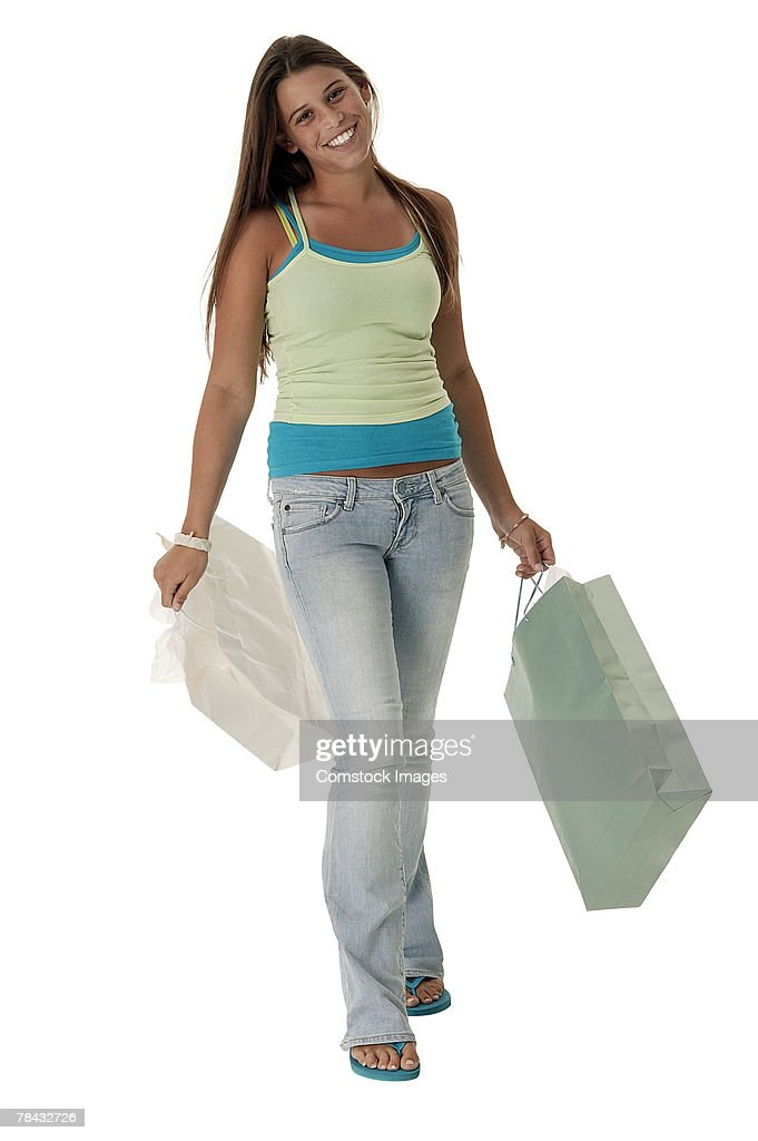 Teenage girl walking with shopping bags : Stockfoto