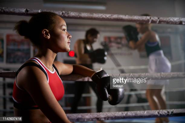 teenage girl watching boxing fight from ringside - women's boxing stock pictures, royalty-free photos & images