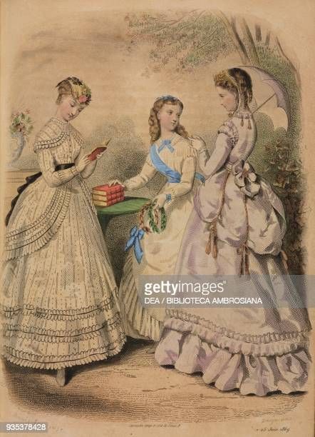 Teenage girl wearing a white organza city dress with polka dots teenage girl wearing a dress for handing out school prizes young woman wearing a...