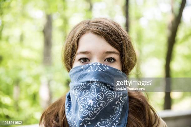 teenage girl wearing bandana over face - bandana stock pictures, royalty-free photos & images