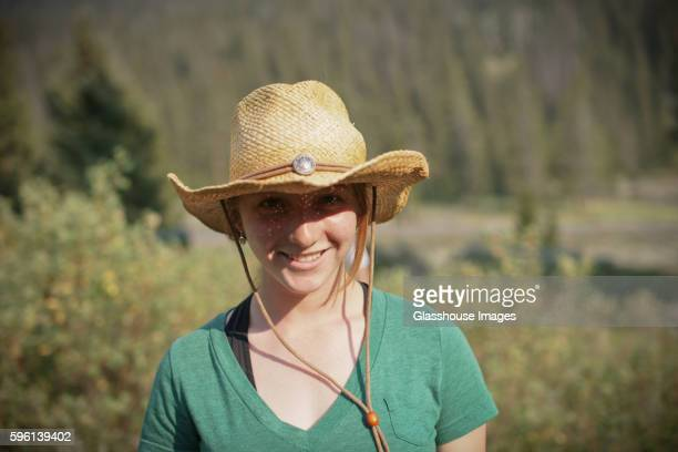Teenage Girl Wearing Cowboy Hat, Portrait