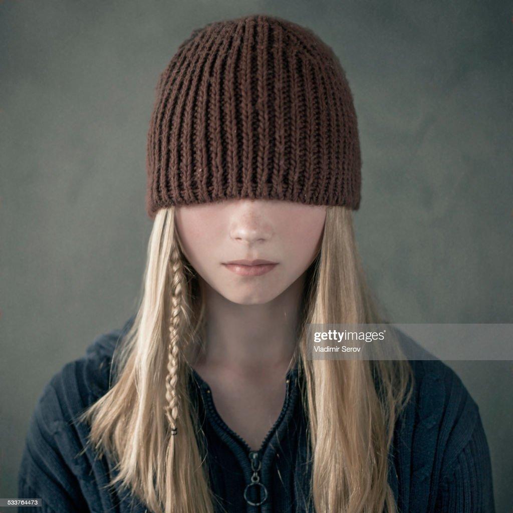 Teenage girl wearing knitted cap over eyes : Foto stock