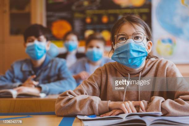teenage girl wearing n95 face mask at school - school child stock pictures, royalty-free photos & images