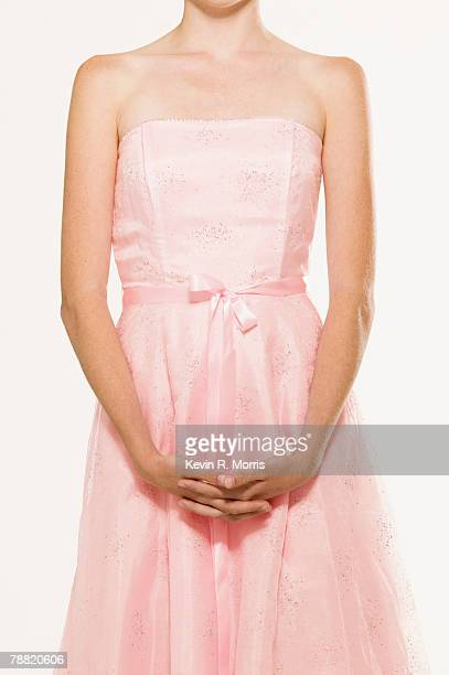 teenage girl wearing pink dress - pink dress stock pictures, royalty-free photos & images