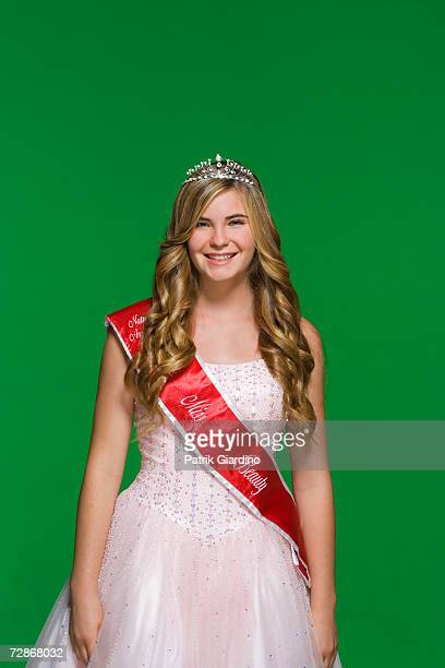 teenage girl (16-17) wearing sash and tiara, smiling, portrait - beauty queen stock pictures, royalty-free photos & images