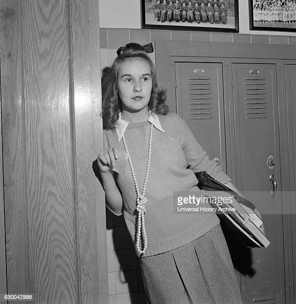 Teenage Girl Wearing Sweater and Long Bead Necklace Woodrow Wilson High School Washington DC USA Esther Bubley for Office of War Information October...