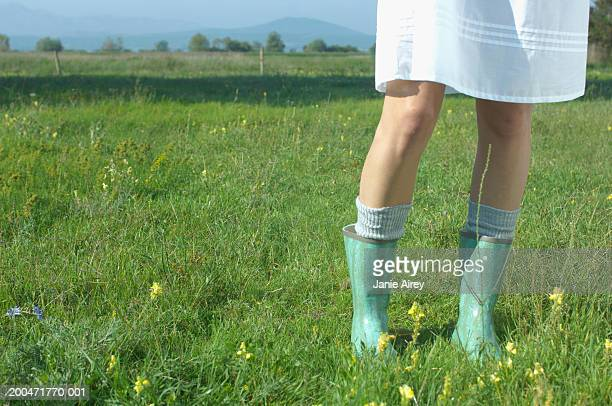 teenage girl (16-18) wearing wellington boots, low section - kneesock stock pictures, royalty-free photos & images