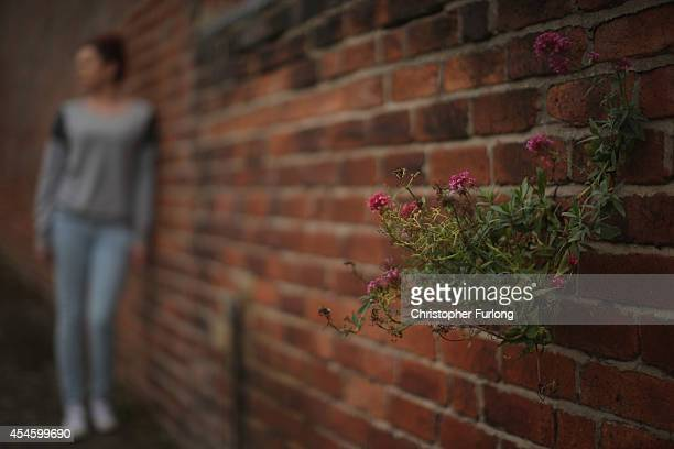 Teenage girl, who claims to be a victim of sexual abuse and alleged grooming, poses in Rotherham on September 3, 2014 in Rotherham, England. South...