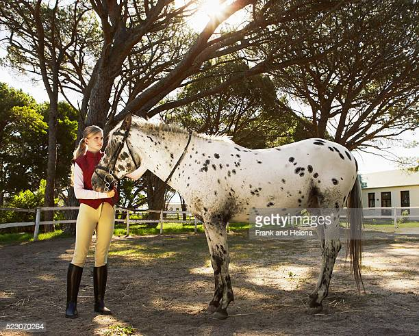 Teenage Girl with Appaloosa Horse