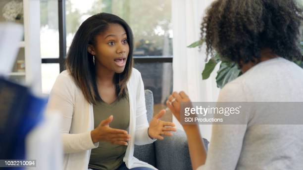 teenage girl with attitude argues with mom - confrontation stock pictures, royalty-free photos & images