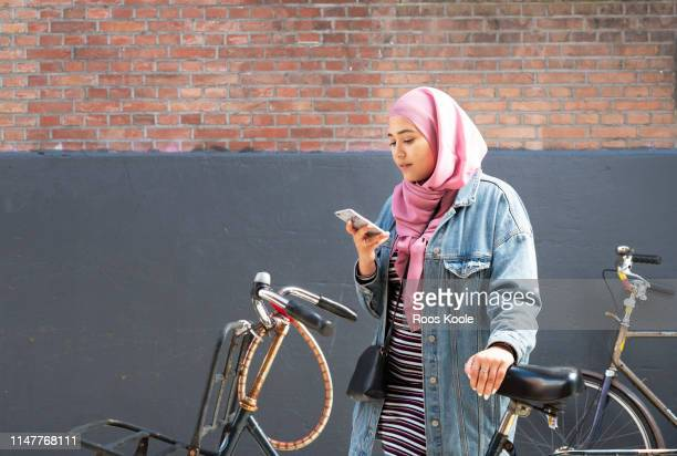 Teenage girl with bicyle