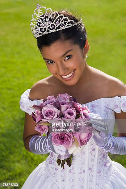 Teenage girl with bouquet at quinceanera