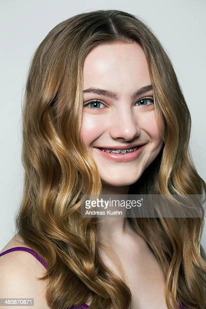 teenage girl with braces smiling, portrait. - beautiful girl smile braces vertical stock photos and pictures