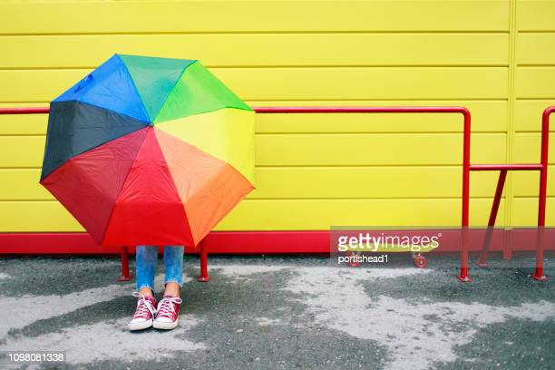 teenage girl with colorful umbrella - red shoe stock pictures, royalty-free photos & images