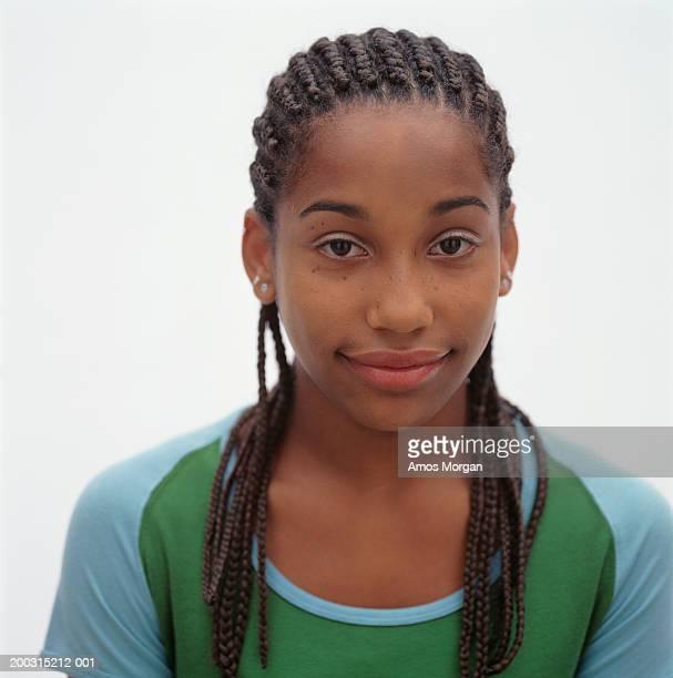teenage girl (16-17) with corn row hairstyle posing in studio, portrait - コーンロウ ストックフォトと画像