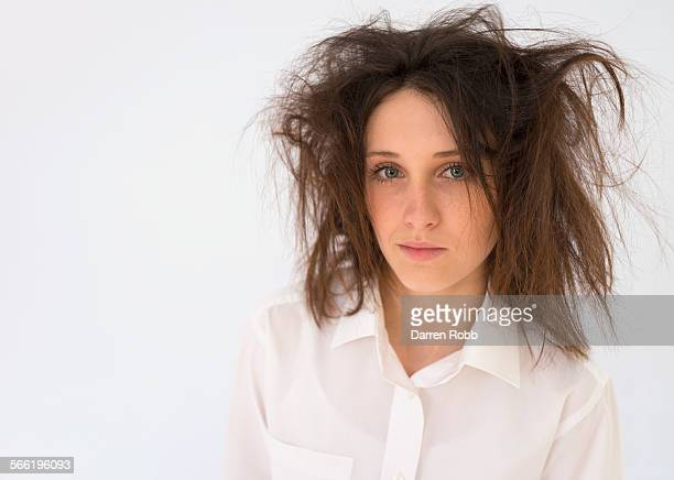 Teenage girl with dishevelled hair