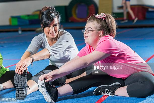 teenage girl with down syndrome in exercise class - down syndrome stock pictures, royalty-free photos & images