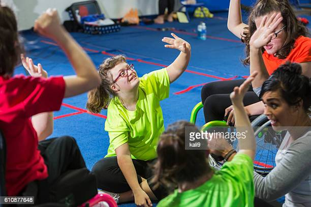 teenage girl with down syndrome in exercise class - physical education stock pictures, royalty-free photos & images