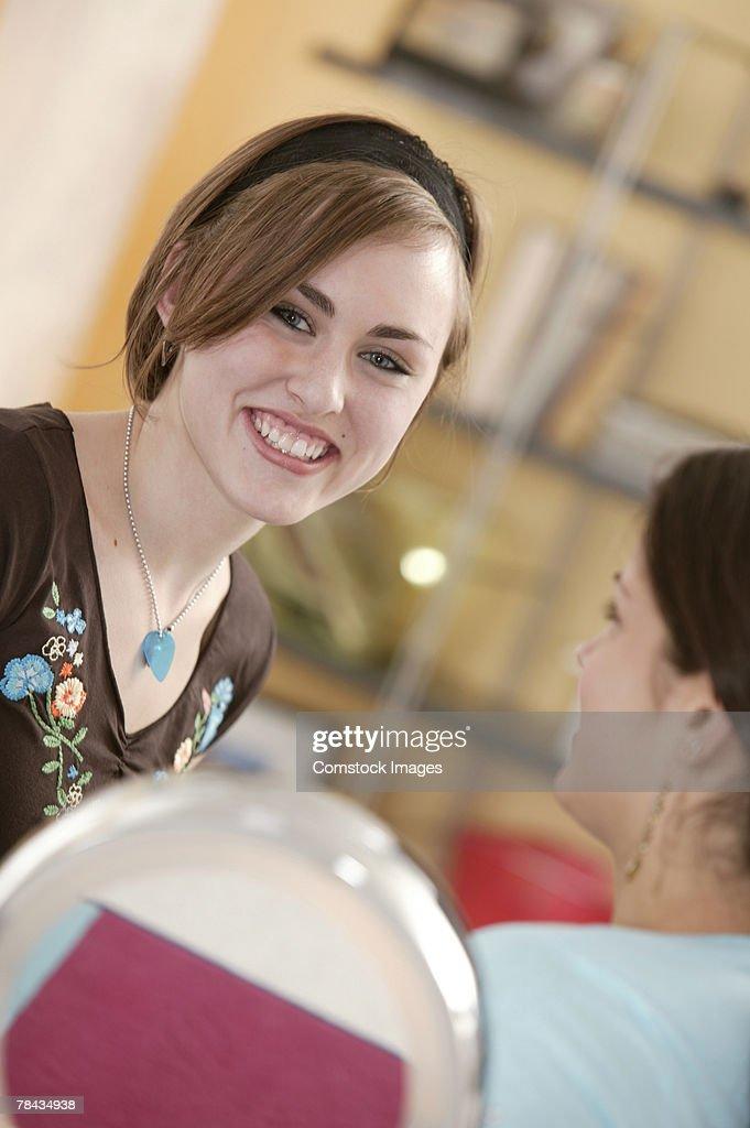 Teenage girl with friend , smiling : Stockfoto