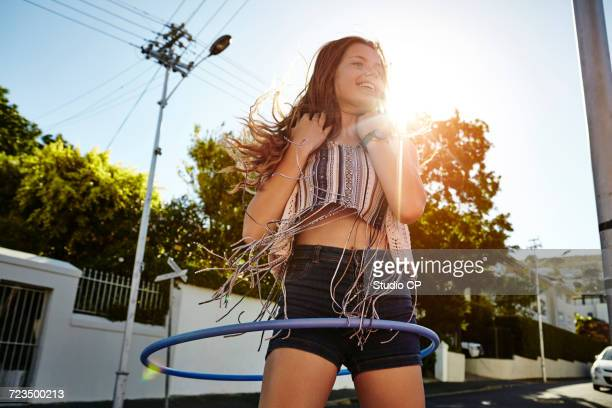 teenage girl with hoola hoop in street, cape town, south africa - crop top stock pictures, royalty-free photos & images