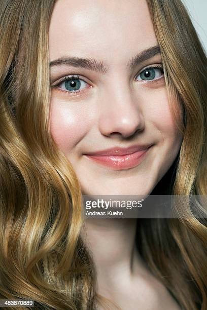 Teenage girl with long blond hair smiling.