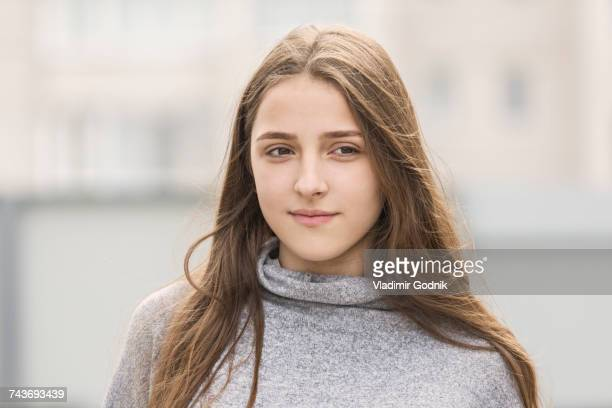 teenage girl with long brown hair standing outdoors - teen russia stock photos and pictures