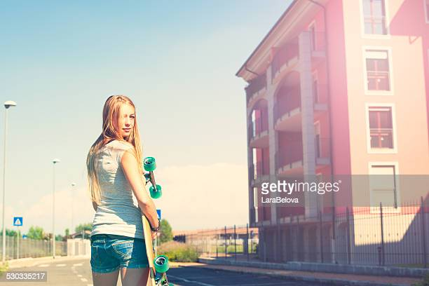 teenage girl with longboard - girls fanny stock photos and pictures