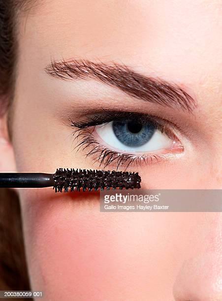 Teenage girl (14-16) with mascara by eye, close-up