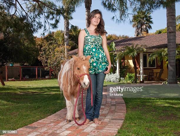 Teenage girl with mini horse
