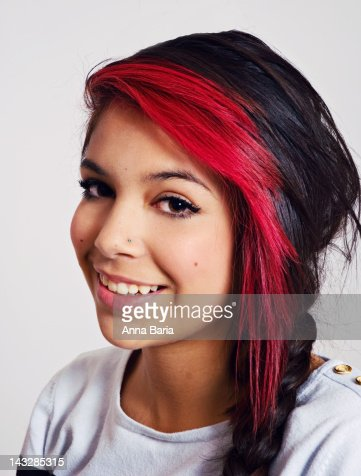 Teenage Girl With Red And Black Hair Smiling Stock Photo