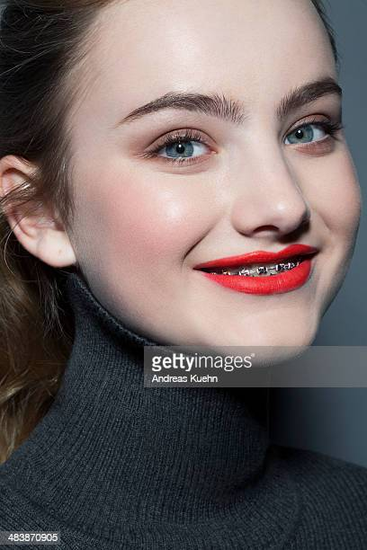 teenage girl with red lip stick and braces. - beautiful girl smile braces vertical stock photos and pictures