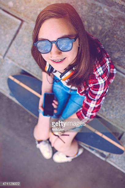 teenage girl with skateboard - brace stock pictures, royalty-free photos & images