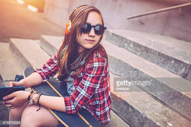 teenage girl with skateboard - one teenage girl only stock pictures, royalty-free photos & images