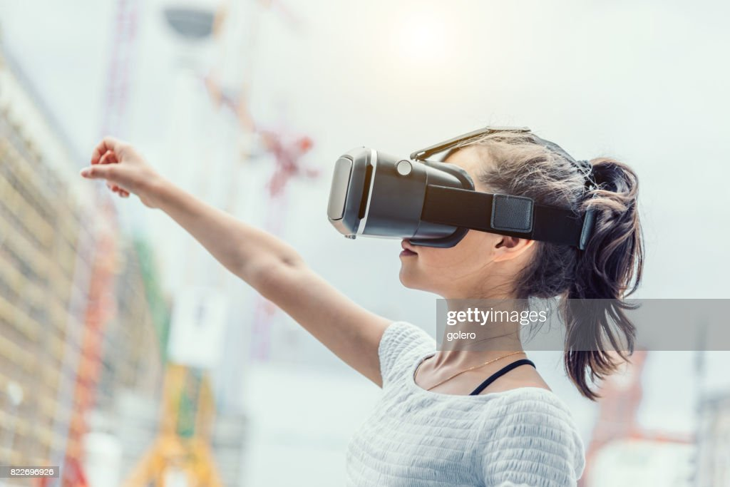teenage girl with virtual reality simulator outdoors : Stock Photo