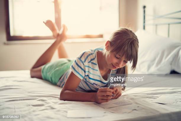 teenage girl writing vacation postcards - writing stock pictures, royalty-free photos & images