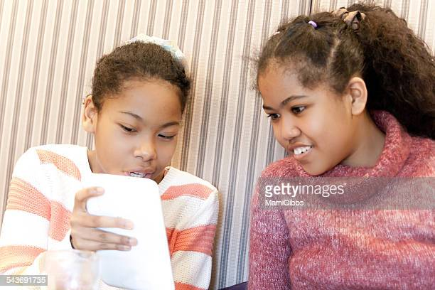 teenage girls are enjoy with tablet - mamigibbs stock photos and pictures