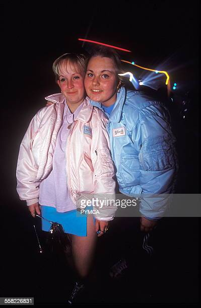 Teenage girls at an under 18s club pose in matching Schott bomber jackets with the velcro badges swapped 20/11/99