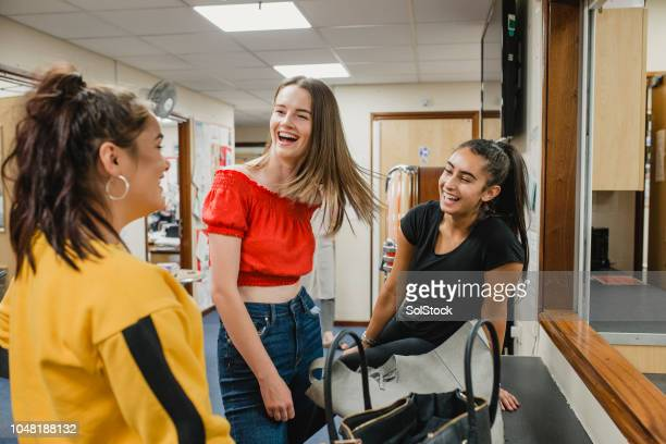 teenage girls at youth club - community centre stock pictures, royalty-free photos & images