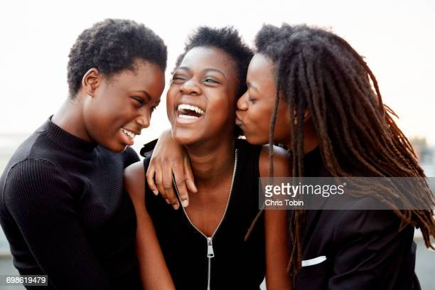 teenage girls being happy - black people kissing stock pictures, royalty-free photos & images
