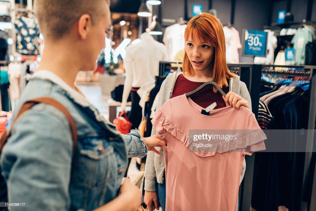 Teenage girls buying summer clothes : Stock Photo