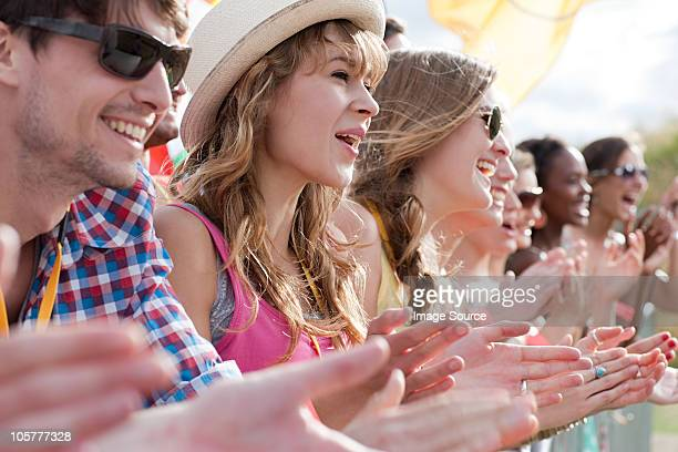 Teenage girls clapping at festival