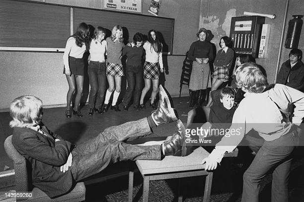 Teenage girls dance together while teenage boys look on at a Saturday morning disco run by the Zetters leisure company in Wolverhampton 15th January...
